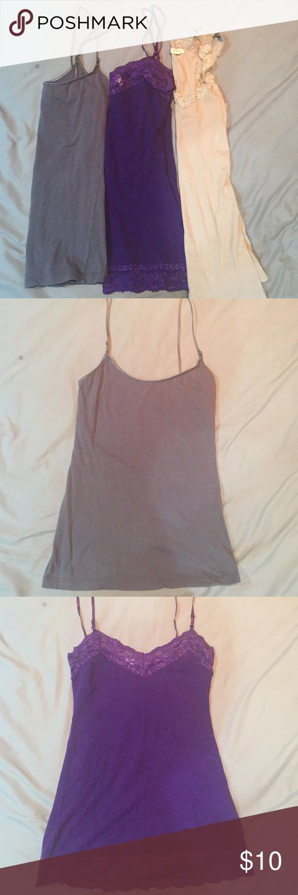 3 tank/cami bundle Grey is Tresics brand Sz M no issues, Purple is Bozzolo brand Sz L (fits like M) elastic on lace has some signs of wear but still great for layering. Inside tag had the stitch come off one side but it doesn't effect wear. Beige is Bozzolo brand and size L (fits like M) no issues. Bozzolo Tops Camisoles