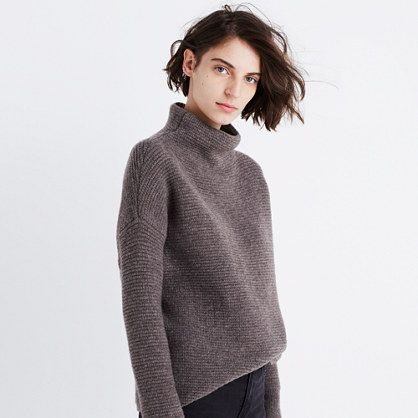 A reach-for-it-daily mockneck in a supersoft and cozy new yarn. With its easy cocoon shape, it's a sweater made for snuggling. <ul><li>Acrylic/wool/nylon/elastane.</li><li>Hand wash.</li><li>Import.</li></ul>