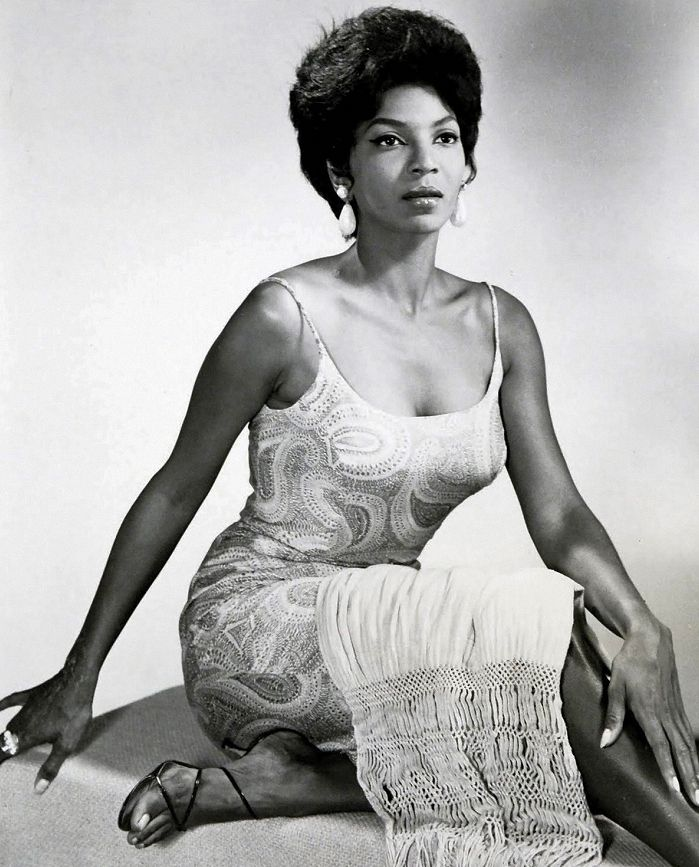 Singer & Actress Nichelle Nichols. 1967. Known best for her ground-breaking role as Lt. Uhura, a USS Enterprise bridge officer on the sci-fi TV series Star Trek. She also traveled with Duke Ellington's & Lionel Hampton's bands, sang at the Chicago Playboy Club, & appeared in several stage plays including James Baldwin's Blues for Mister Charlie. She  volunteered for NASA to recruit minorities. Astronaut Dr Mae Jemison & Comedian/Actress Whoopi Goldberg cites Nichols as career inspirations.