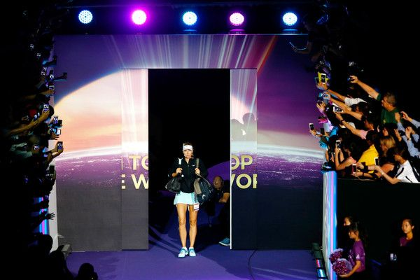 Maria Sharapova Photos Photos - Maria Sharapova of Russia walks onto the court prior to her round robin match against Simona Halep of Romania during the BNP Paribas WTA Finals at Singapore Sports Hub on October 27, 2015 in Singapore. - BNP Paribas WTA Finals: Singapore 2015 - Day Three