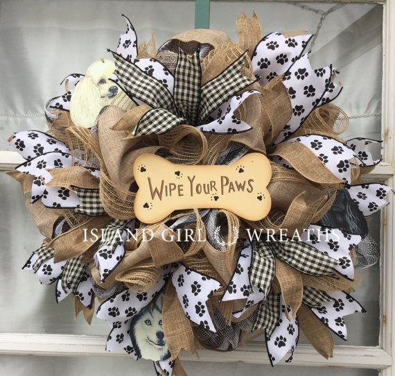 This wreath can be customize only two ways 1-The dogs ornaments can be changed 2-Artificial greenery and flowers can be added. Please contact me before you make your purchase if you would like anything changed. This wreath is made on a work wreath form using the following: 21 wide black and white stripe deco mesh 10 wide jute deco mesh 6 wide linen wired ribbon. 3 different styles of wired ribbons 1 wooden wipe your paws dog bone sign 3 dog ornaments Its 20 wide and 7 in depth. Its made…