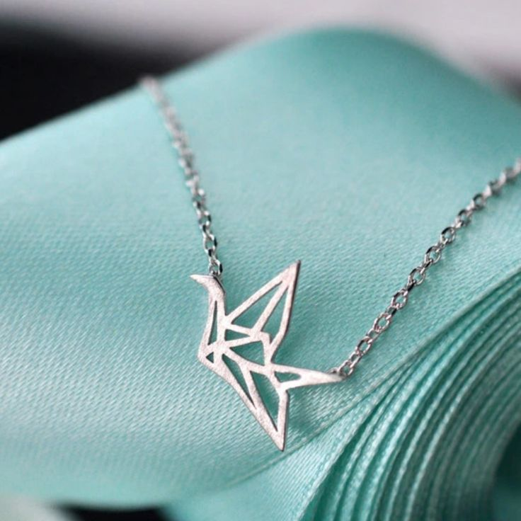 This origami crane necklace is made from 925 Sterling Silver, and its elegant design will be sure to bring a smile to any bird lover! - Solid 925 Sterling Silver FREE SHIPPING - 30 Day 100% Money Back