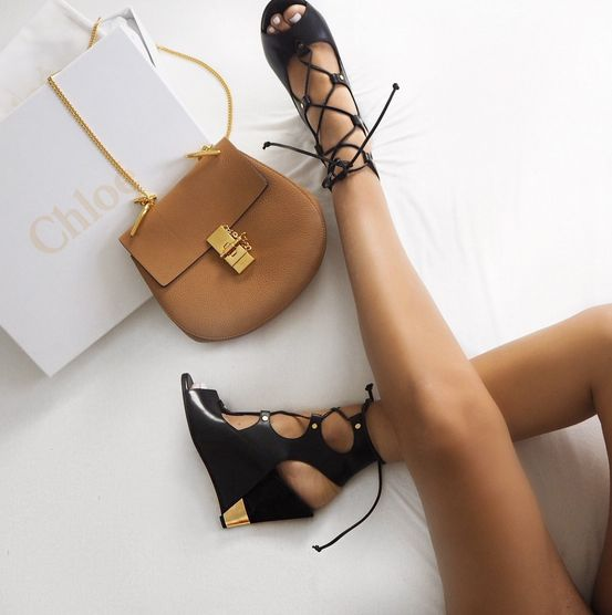 We love this tan Chloe shoulder bag and these black open toed corset wedges