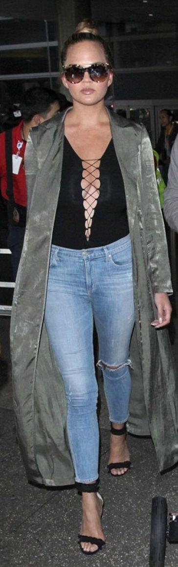 Chrissy Teigen: Shoes – Gianvito Rossi  Sunglasses Alexander McQueen  Coat – Naked Wardrobe  Jeans – Frame  Shirt – T by Alexander Wang