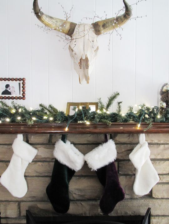 holiday mantel+christmas mantle+stockings on the fireplace+cow skull with holiday decor+light