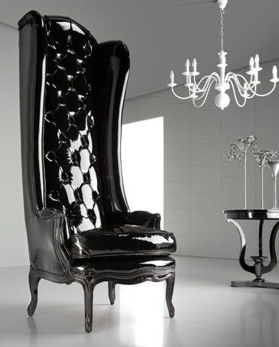 Express yourself with the Modern Glamour black lacquered porters chair. Upholstered in high black gloss patient leather with a black lacquered paint finish. Offering the most dramatic of effects for any setting!