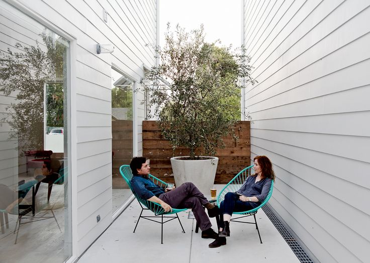By taking advantage of economies of scale, a Houston native and a pair of mod-minded developers team up to create nine affordable row houses in the Houston Heights.