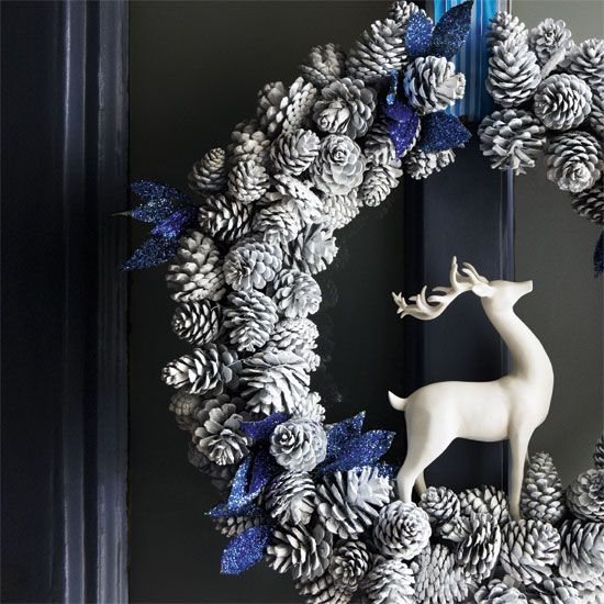 pinecones painted white with blue ribbon and white deer...or could do snowman or snowflake