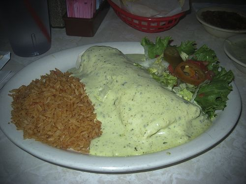 Chuy's Bean and Cheese Burrito with Deluxe Tomatillo Sauce.