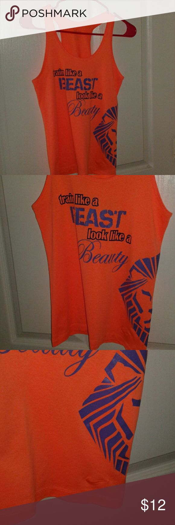 "Nike dri fit tank top -size s Nike dri fit racer back tank top-neon like orange.Front is adorable with ""train like a beast. Look like a beauty"" with the lion insignia on bottom side. Back has alpha female Nike Tops Tank Tops"