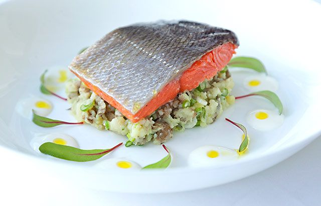 Poached Alaska salmon with crushed horseradish Jersey Royal new potatoes - Adam Gray's elegant salmon and new potato dish marries perfectly cooked confit salmon with horseradish crushed Jersey Royals to make a summery dinner party dish