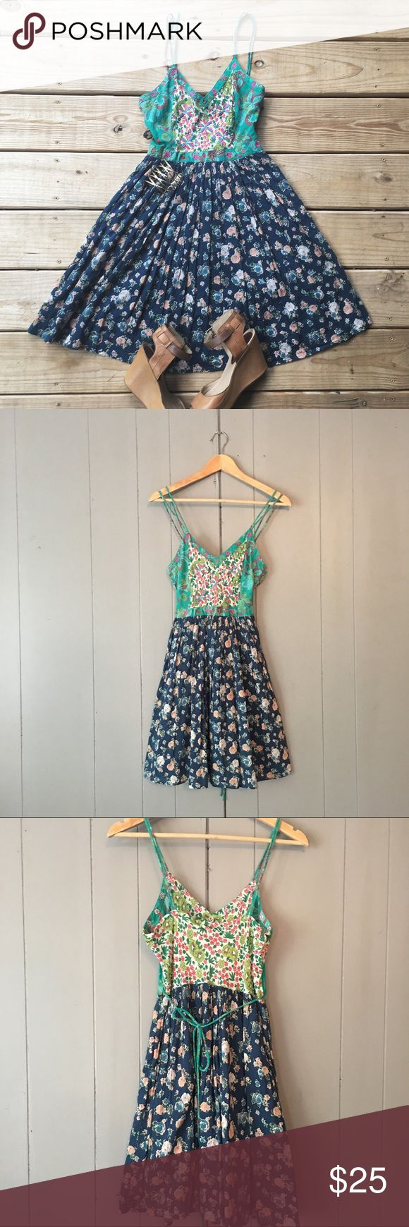 """Gorgeous Patrons of Peace floral sun dress This mini Fit & Flare is perfect for that summer boho chic look. The details and colors on this dress are simply beautiful. Skirt is lined and pleated. Double spaghetti straps and ties in the back. Zips on the side. This dress is in excellent used condition! 100% cotton. Armpit to armpit is 16"""". Top of strap to bottom hem (length) is 35"""".***Stock photo is not the same dress but the same style. Buckle Dresses Mini"""