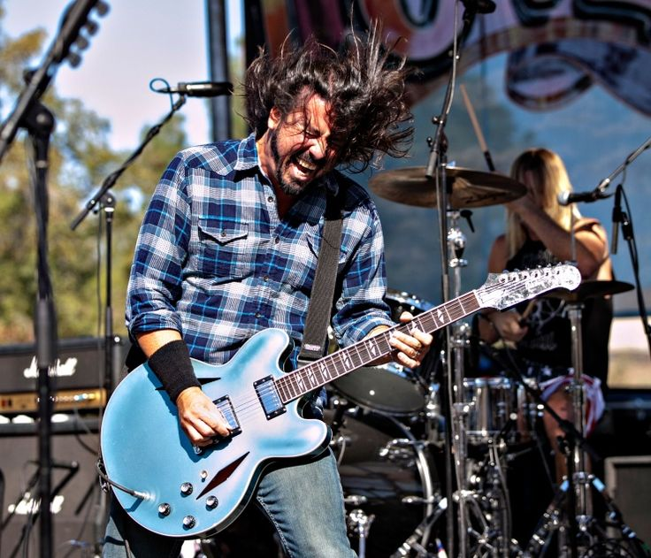 Dave Grohl goes with the flow during a performance at the Love Ride 30th Anniversary concert and motorcycle event on Oct. 20 in Glendale, Calif.: Photo, Motorcycle Event