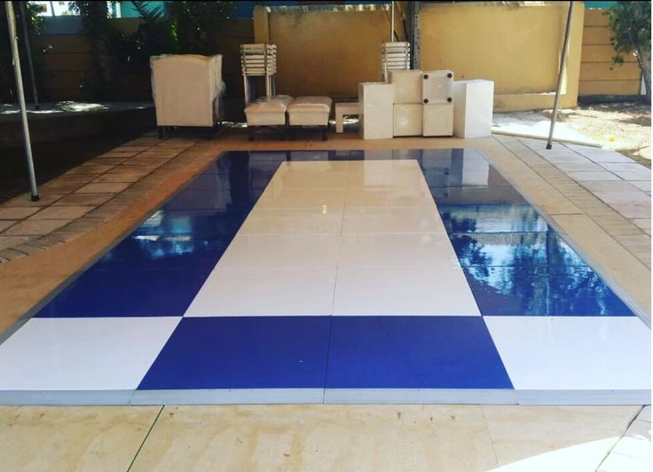 A navy blue and white painted floor. We can create floors in pretty much any color if we are given a sample or a Pantone reference by our clients. #connectafloorcape #eventflooringcapetown
