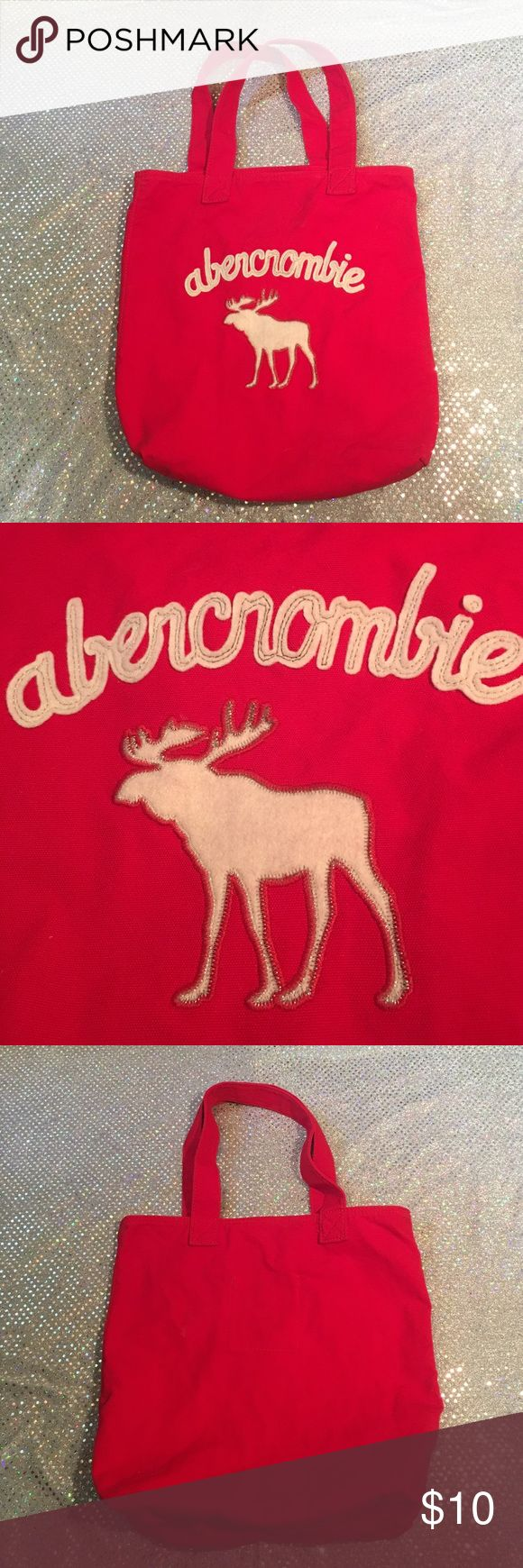 ABERCROMBIE AND FITCH TOTE BAG EXCELLENT condition brilliant red Abercrombie and Fitch kids tote bag. Has inner storage pocket with emblem. Thanks for checking out my closet 🎊HAPPY POSHING🎊😄 abercrombie kids Accessories Bags