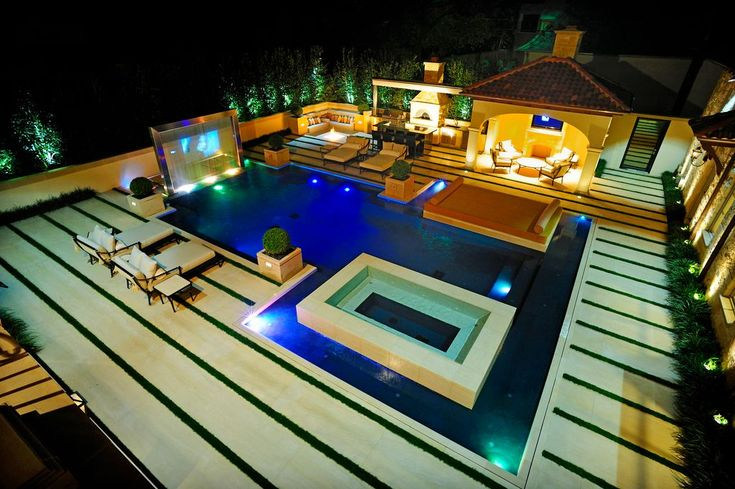 Contemporary Swimming Pool with Fountain, outdoor pizza oven, Outdoor kitchen, Sunken hot tub, Pool with hot tub, Gazebo