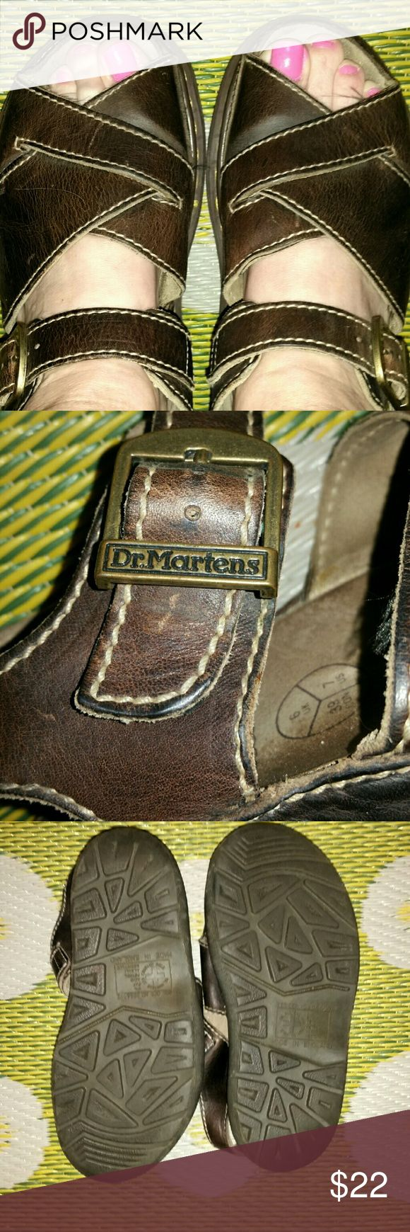 Dr Martin's Brown Leather Sandals Authentic Dr Martin's sandals; previously owned, but Doc's shoes last forever;  size 38 UK, states 7 on inside but defiantly bigger, will fit 7.5 or a small 8 (my size ); foot bed shows foot print from wearing, but other than that they are in great condition, no flaws or issues. Dr. Martens Shoes Sandals