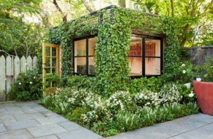 """green walls...the walls are covered with a wire mesh for the plant to climb    jmoinajo edit: I have an old arched pipe shelter made for shade cloth. WHAT if, I covered the """"roof""""  and walls with chicken wire and surrounded with a raised bed of straw bales. You could pick grapes and raspberries from inside the """"green"""" house. in ajo, it could be green year round"""