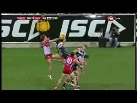 Geelong's #StevenMotlop puts in a decent claim for #AFL Mark of the Year with this screamer!