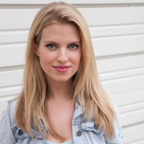 """Barbara Dunkelman is the voice actress for Yang Xiao Long in RWBY. She is also the Marketing and Community Manager at Rooster Teeth Productions, and Co-Director of RTX. She also frequently appears on Rooster Teeth's podcast, and has a reputation for making horrible puns on it. This habit of puns has given her the nickname """"Barbara Punkelman."""" This also seemed to be implemented into Yang's personality, judging from her pun in """"Best Day Ever."""""""