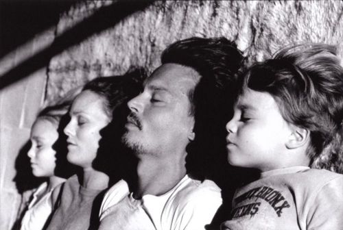 Interesting way to photograph a family. Crazy good looking family that is--Johnny Depp and Vanessa Paradis and their mini-me's.