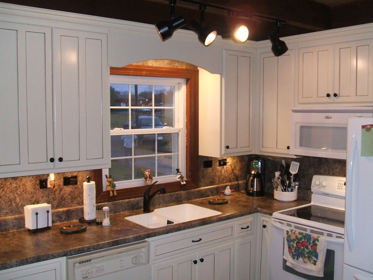 White Kitchen Countertops With Brown Cabinets