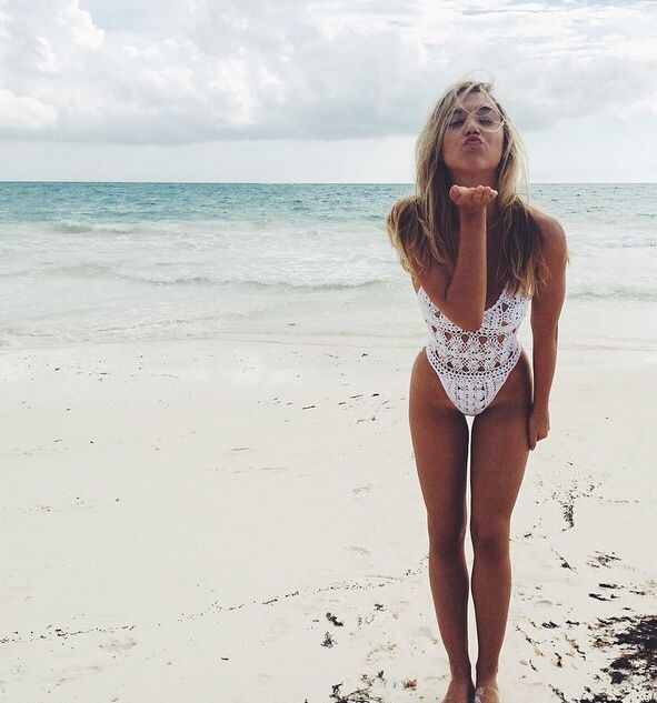Beach beauty in white onesie suit
