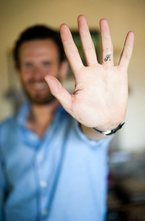 Spouse's initial on your ring finger.