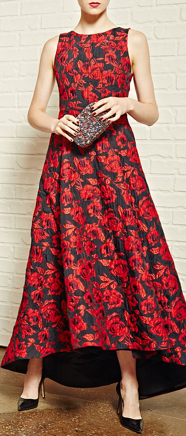 Go bold or go home. Opt for rich floral jacquards for every moment and mood this fall with Alice + Olivia. Stunning floral motifs impart eye-catching elegance to this sharply tailored gown, cut with a statement hi-lo hem. Click to see more fall fashion inspiration with our COLLECTION editorial event.