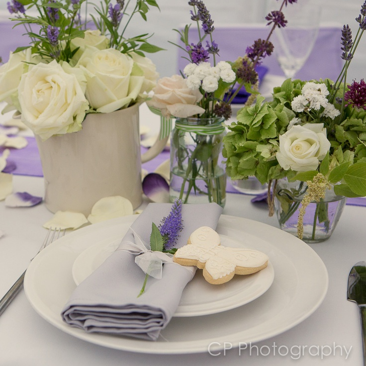 Vintage floral arrangements by the White Horse Flower Company, look stunning with Fuschia's platinum napkin and ribbons with a white shortbread cookie.  By www.fuschiadesigns.co.uk.