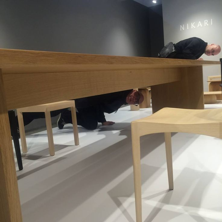 Eero Koivisto & Mårten Claesson of Claesson Koivisto Rune checking out the fantastic woodwork on their EDI table at the NIKARI stand in Milan 2015.