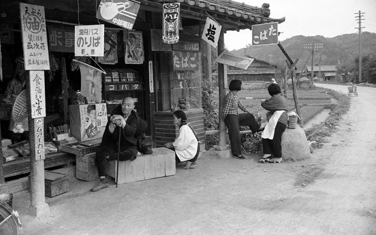 "Bus stop at Shingu, 1956 || At a bottom left there is a sign ""ムアーカレー/Muakare"", a…"