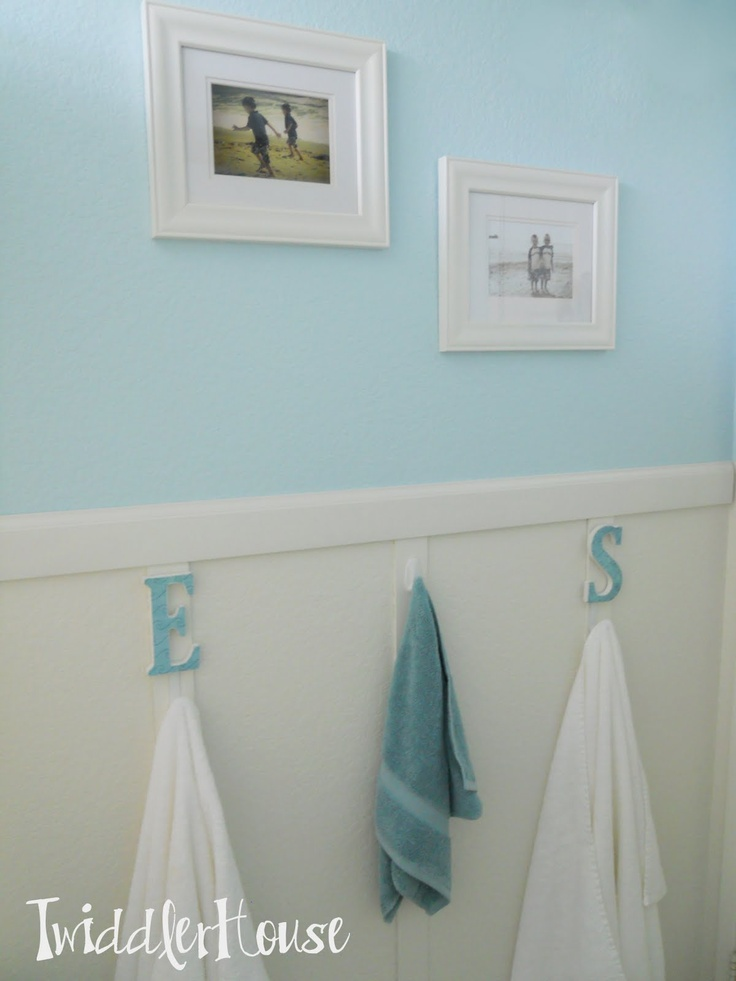 BEACHY BATHROOM  I like the colors used and the white wainscoting with teh picture frame