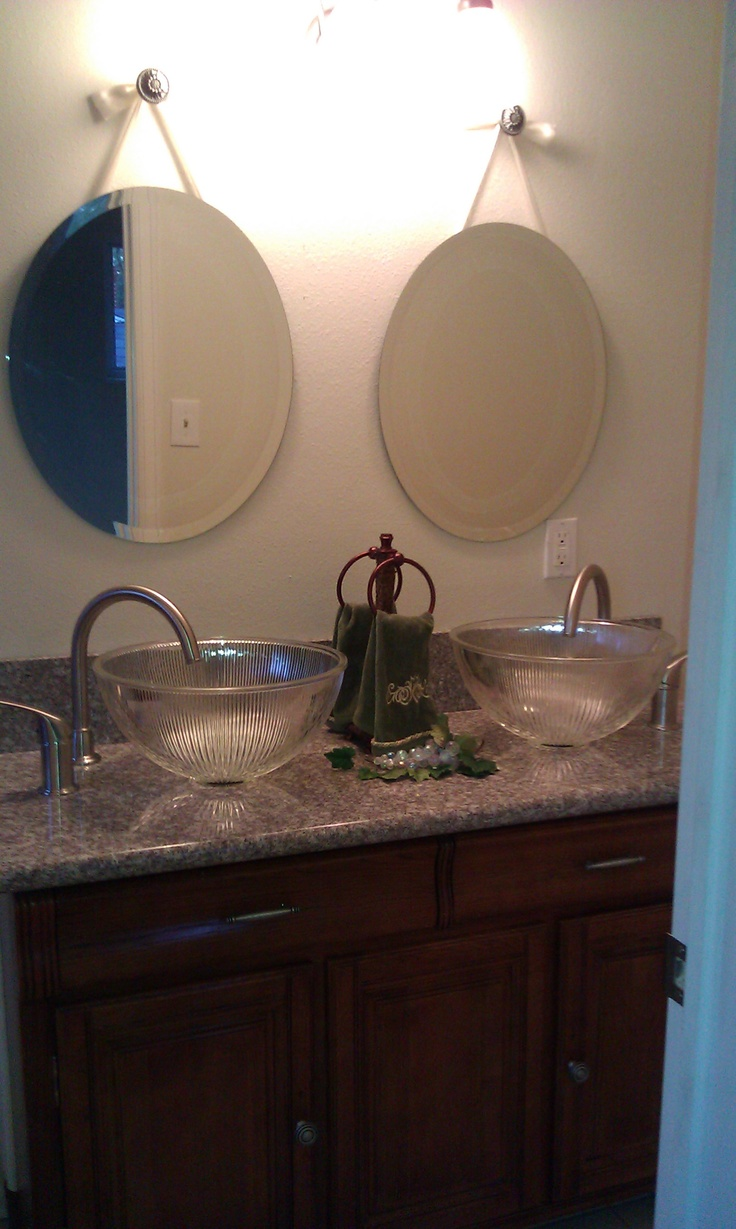 Take cheap light fixtures, kitchen faucets and add a granite top to a buffet. You have a one of a kind bathroom vanity!