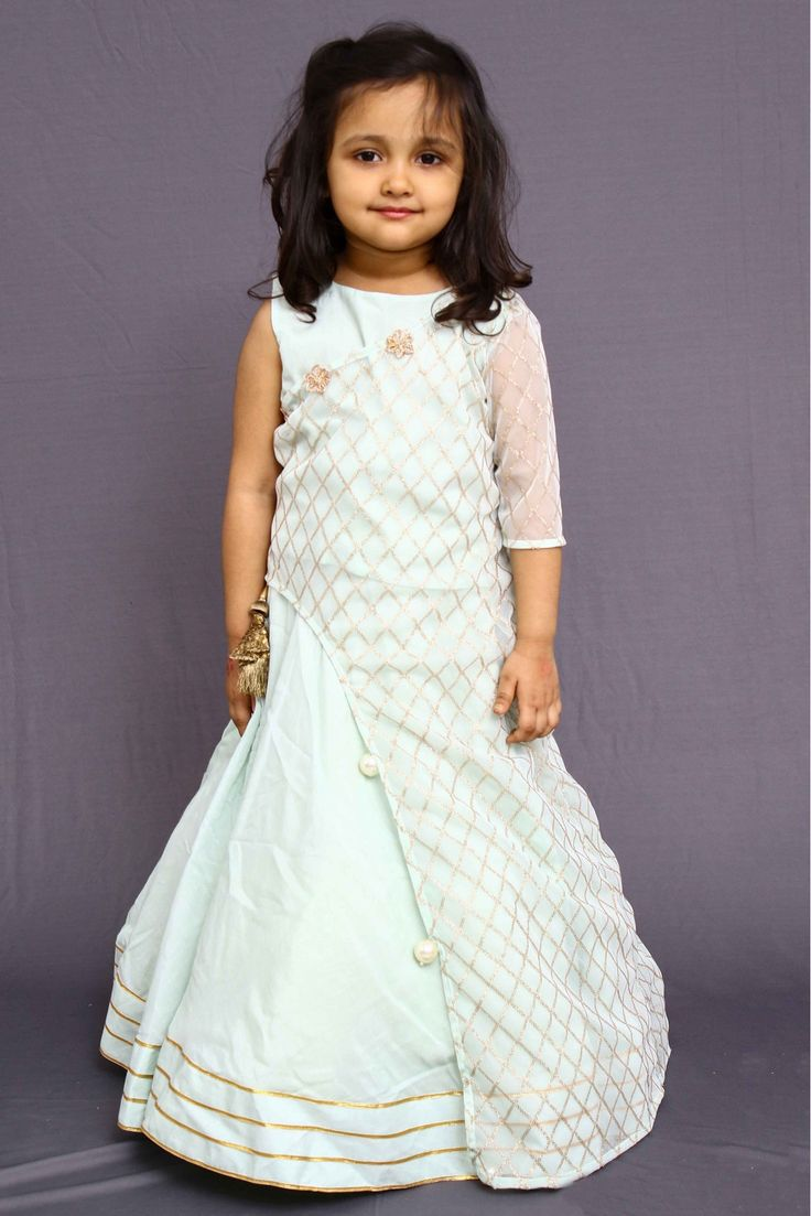 This New Year! Designer Cotton Silk And Net Party Wear Lehenga Choli In White Colour. #girlslehenga #girlslehengacholis #cholisuitsforgirls #kidslehengaonline