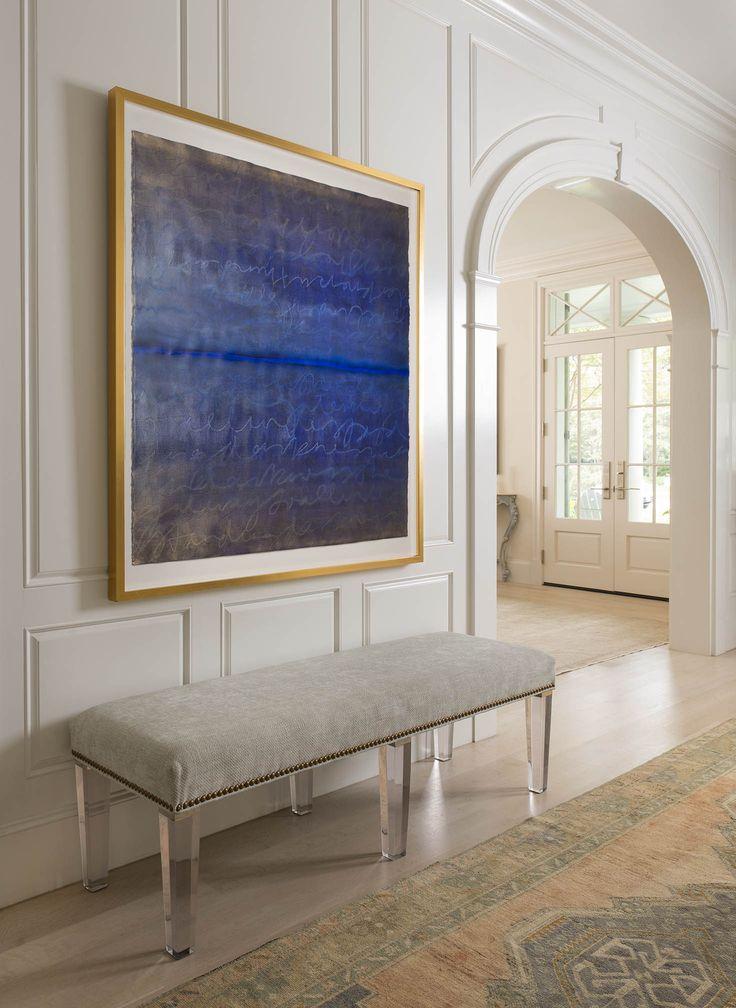 SIMPLE BUT ELEGANT ENTRYWAY | Neutral and bold artwork | bocadolobo.com/ #modernentryway #entrywayideas