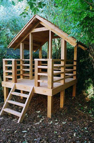 Western red cedar play house with porch and cedar shingle roof