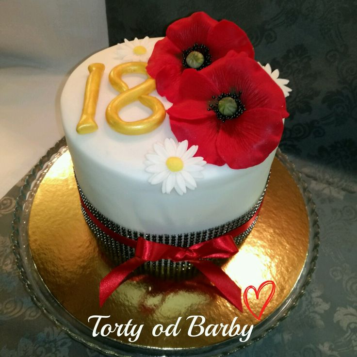 Cake with popis flower and Red ribbon