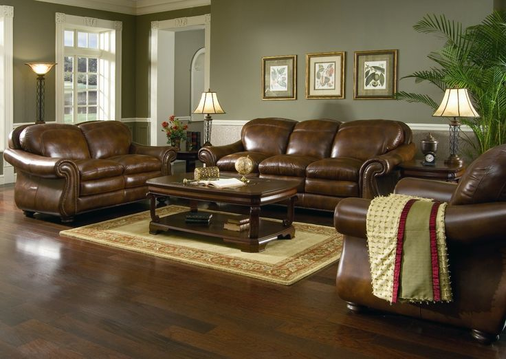 Classic Leather Couch In Living Room Designing Use Lamps Standing Beside Sofa As Well Frame On Gray Wall Paint Also Dark Brown Table In Beige Rug Wonderful