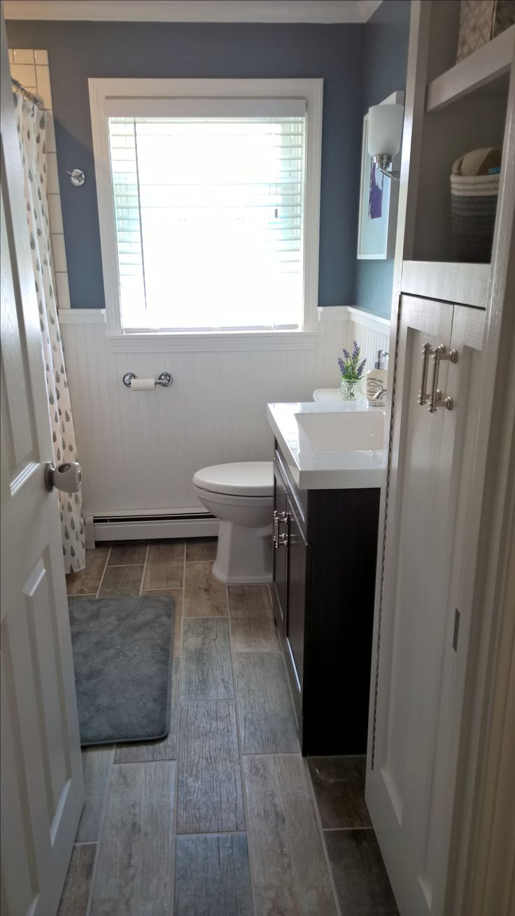 "Bath remodel-storm cloud color by Sherwin Williams, Lowe's vanity, ""driftwood"" floor tile, subway tile bath surround"