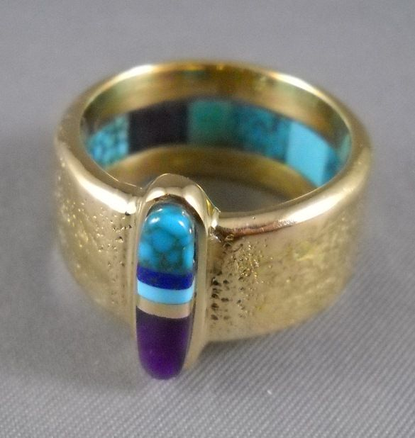 Charles Loloma - Native American Artist - Hopi. Gold cast band ring with inlay of turquoise, lapis, sugulite and gold. Awesome.