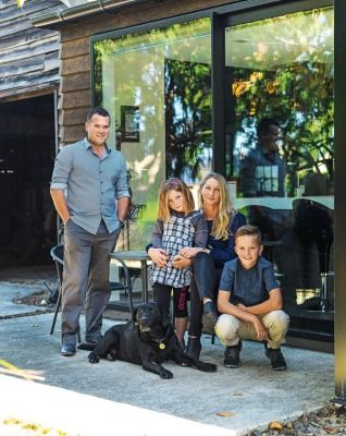 The Warnock family, from left, Reece, Jorja, Kelly and Josh with their black labrador Tess.