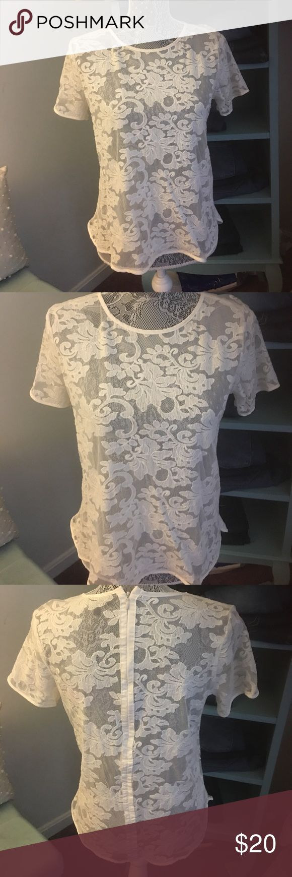 Cream lace top Cream lace short sleeve top with a back zipper. Supa cute worn once 🎀🎀🎀 The Limited Tops