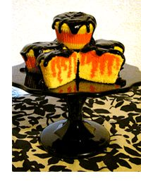 Halloween cupcakes--yellow poke cake with orange jello and chocolate icing!: