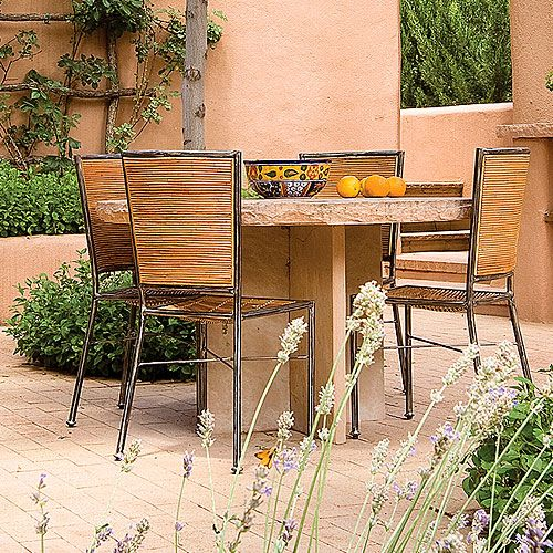 Flagstone furnishings:  This custom-built dining table is right at home in this Southwestern courtyard.