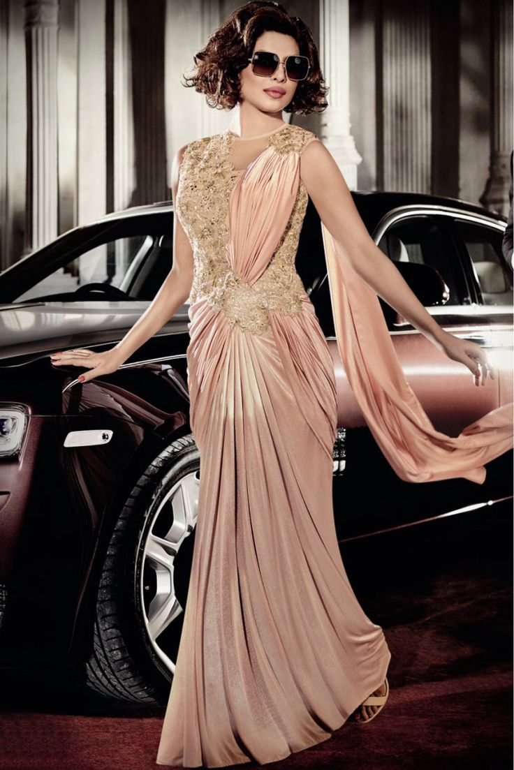 Bollywood Priyanka Chopra Lycra Designer Suit in Pink Colour.It comes with matching Dupatta and Bottom.It is crafted with Embroidery,Sequins Work...