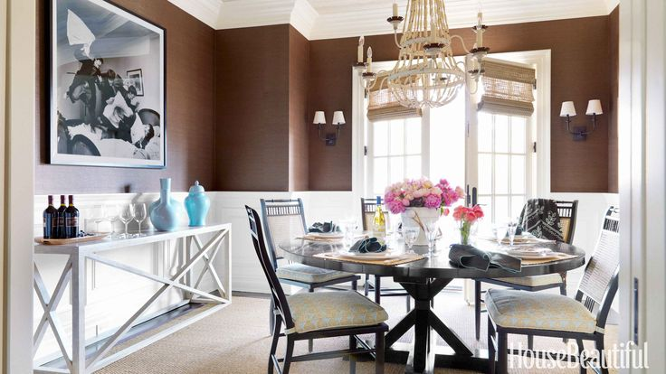 """If you love rich browns in your decor, you """"take your obligations seriously, are industrious, and value the respect of those close to you,"""" Smith says. Chocolaty brown grass cloth — Sisal in Sable from Clarence House — adds intimacy in the dining room of an Old Greenwich, Connecticut, house designed by Lee Ann Thornton.   - HouseBeautiful.com"""