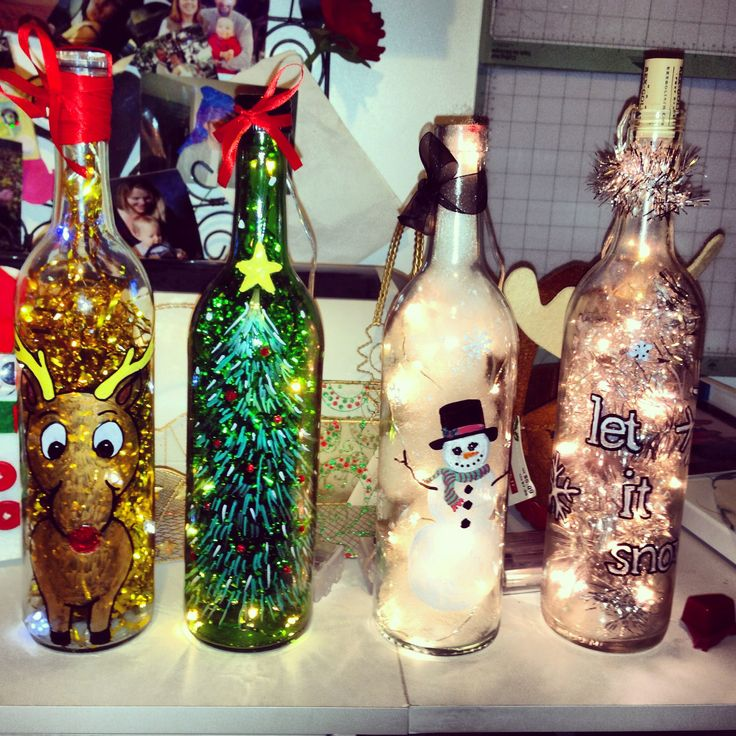 I used paint pens to decorate wine bottles, sealed with Mod Podge and added battery powered LED lights