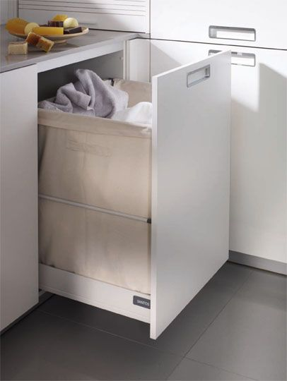 SANTOS kitchen | Solutions for the laundry    Unit with laundry bag. Near the cupboard containing the washing machine and dryer a base unit has been installed with a cloth bag for clothes. This unit has been designed to keep dirty clothes until they are washed.