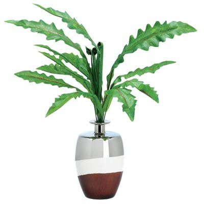 """Enjoy the beauty of lush greenery but skip the messy upkeep! Lifelike fabric plant in its own elegant vase is perfect for home or office, adding a touch of the tropics to liven any setting.Weight 2.4 lbs. 6"""" diameter x 23"""" high; vase is 9"""" high. Faux plant and ceramic vase."""
